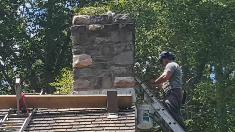 Affordable Mason pointing and repairing chimney